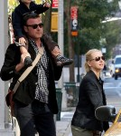 Naomi Watts walks with Liev Schreiber, who carried their son Sasha on his shoulders, before hailing a taxi in Tribeca.