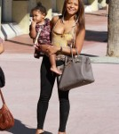 Christina Milian out shopping, eating and playing by the fountain with her daughter Violet Nash in Miami, Florida on October 22, 2011