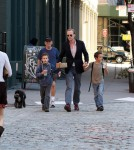 Paul Bettany walks in Tribeca with his two boys and a friend.