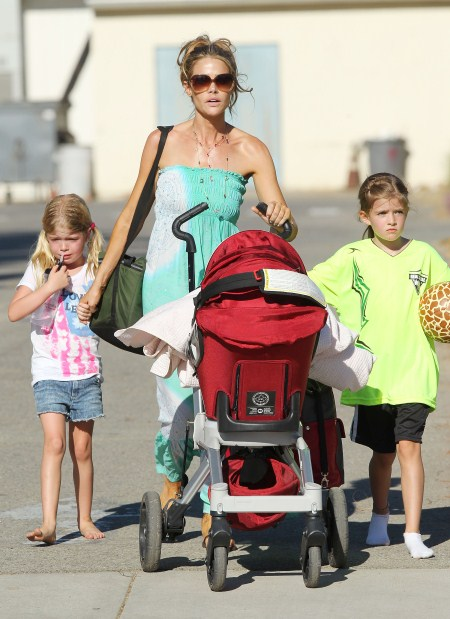 Denise Richards takes her girls Lola Sheen and new baby Eloise Richards to cheer on big sister Sam at her soccer game in Los Angeles, CA on October 1, 2011.