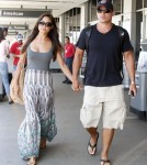 Newlyweds Nick Lachey and Vanessa Minnillo touched down at the LAX airport in Los Angeles, California on July 25, 2011 after their honeymoon in St. Barths. The happy couple smiled as they showed off their tan strolling through the airport to their car.