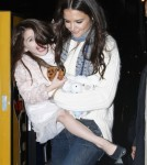 Suri Cruise Makes Faces at the Paparazzi As Mom Katie Holmes Holds Her