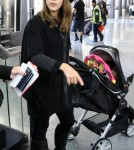 Jessica Alba was chic in all black as she arrived at the airport with her new daughter Haven in Los Angeles, California on November 5th, 2011.