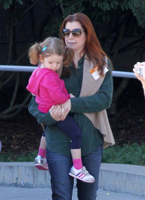 Alyson Hannigan enjoyed at day at The Skirball Cultural Center with her husband Alexis Denisof, their young daughter Satyana and her grandparents on November 22, 2011 in Los Angeles, California.