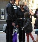 Hugh Jackman enjoys an apple while waiting for his wife, Australian actor Deborah-Lee Furness, and their daughter Ava in New York, New York on November 2, 2011.