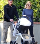 January Jones and her father Marvin spend a bit of time together as they take Jones' son Xander for a walk around the neighborhood.