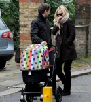Kate Hudson and Matthew Bellamy wrap up warm as they stroll with their baby son, Bingham Hawn Bellamy, in London.