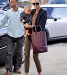 Miranda Kerr is spotted out and about with a bundled up baby Flynn Bloom in NYC.