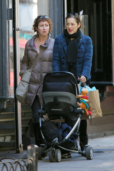 Marion Collitard Shops with her son Marcel in New York City