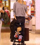Miranda Kerr and son Flynn at FAO Schwarz (November 14)