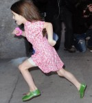 Suri Cruise runs past photographers on her way home as mom, Katie Holmes strides in at a more normal speed on November 7, 2011 in new York City, New York.