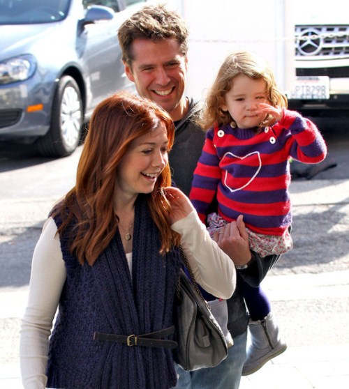 Alyson Hannigan and husband Alexis Denisof and their daughter Satyana went shopping in Brentwood, ca on December 4, 2011