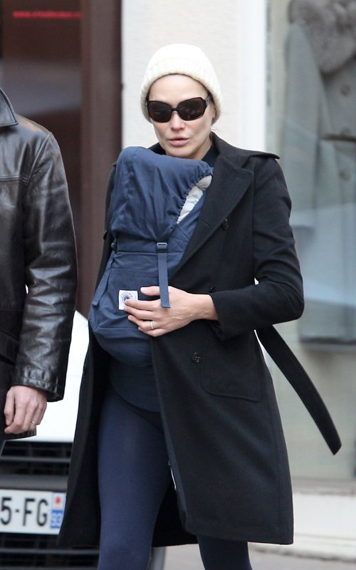 Carla Bruni-Sarkozy taking a stroll around Paris with her baby (December 6).