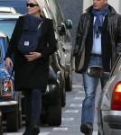 Carla Bruni-Sarkozy taking a stroll around Paris with her baby (December 6).