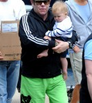 Elton John holds his son Zachary Jackson Levon Furnish-John before boarding a yacht in the Sydney Harbour for a party