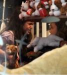 Suri Cruise and Katie Holmes at New York's FAO Schwartz toy store (December 14)