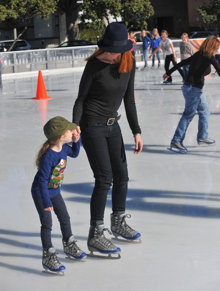 Marcia Cross and her husband Tom Mahoney take their daughters Eden and Savannah ice skating in Santa Monica.