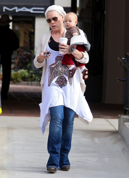 Pink takes baby Willow Hart out for some playtime at the park in Los Angeles, CA on December 11, 2011.
