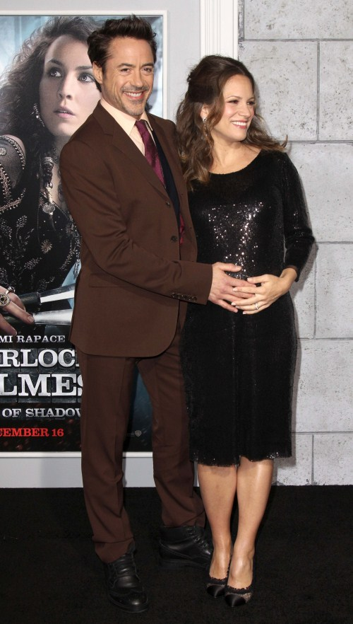 "Robert Downey JR and Wife Susan Downey at the premiere of ""Sherlock Holmes: A Game Of Shadows"" red carpet premiere at Regency Village Theatre in Westwood, Los Angeles, California on December 6, 2011."