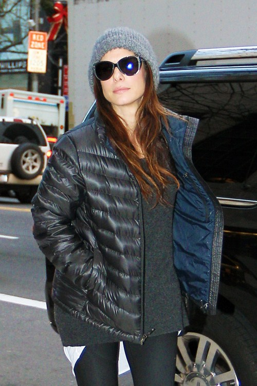 sandra-bulloSandra Bullock keeps warm in a grey beanie and goose down jacket as she is spotted leaving a gym in New York. Bullock, 47, sports sunglasses as photographers take pictures before entering a black SUV. December 14 2011