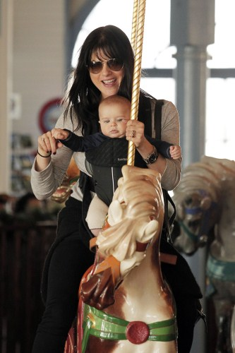 Selma Blair takes her adorable baby son Arthur on a carousel ride at the Santa Monica Pier