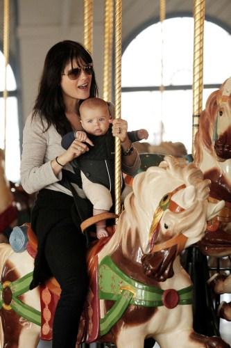 Selma Blair takes her adorable baby son Arthur on a carousel ride at the Santa Monica Pier