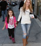 """TV series actress Lilit Vivian of """"The Sinners"""" and her daughter made their way back to the parking structure after a visit to the doctors office on December 8, 2011 in Beverly Hills, California."""