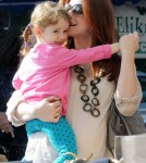BABY BUMP ALERT! Alyson Hannigan, who is currently pregnant with her second child, takes her daughter Satyana to play at the park with husband Alexis Denisof