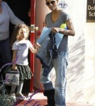 Superstar Halle Berry is spotted wearing a black cast on her leg while picking up her daughter Nahla from school