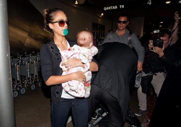 Jessica Alba, Cash Warren, and their daughter Haven Garner arrive at LAX