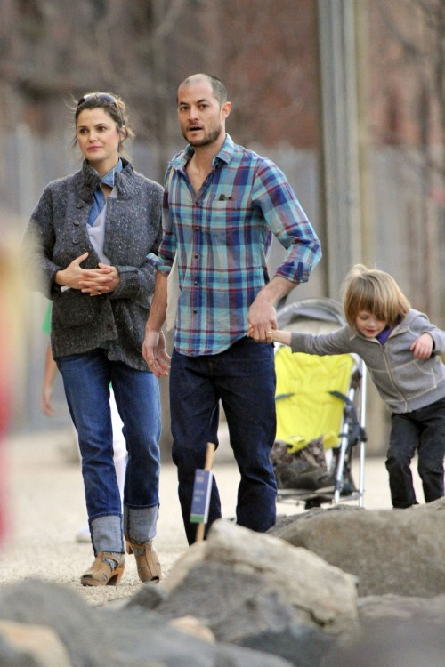 Keri Russell carries her newborn daughter Willa Lou in a baby carrier under her sweater as she heads to a carousel in Brooklyn with her family