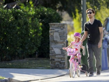 Tobey Maguire Takes Ruby For A Bike Ride