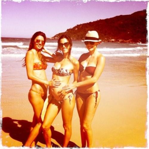 Alessandra Ambrosio shows off her bump in a bikini while in Brazil Via Twitter