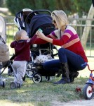 Ali Larter takes her adorable baby son Teddy to the park to play on the swings and in the sandbox 01-03-2012