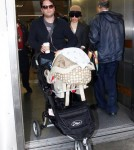 Elizabeth Banks and husband Max Handelman touch down at LAX in Los Angeles, CA with baby Felix Handelman on January 22, 2012
