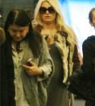 Pregnant Jessica Simpson Flies Into LAX