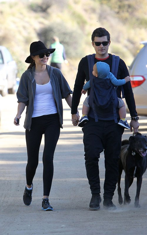 Orlando Bloom and his wife Miranda Kerr take their baby son Flynn for a hike in Runyon Canyon on his birthday.