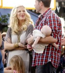 "Tori Spelling and her family are interviewed on ""Extra"" at The Grove on January 25, 2012 in Los Angeles, CA."