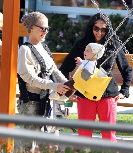 Pink and her daughter Willow Hart out shopping at 98% Angel and then getting on a swing set in Malibu, CA on February 18, 2012.