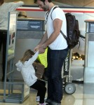 Alessandra Ambrosio, husband Jamie Mazur and daughter Anja arriving for a flight at LAX airport in Los Angeles, CA on February 3, 2012.