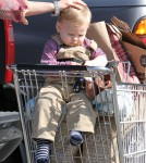 Ali Larter and her son Theodore MacArthur made their way back to the car after a shopping trip at the local Whole Foods Market in Los Angeles, California on February 1, 2012.