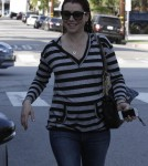 Pregnant actress Alyson Hannigan was all smiles as she left the hair salon with her red locks still very wet in West Hollywood, California on February 3, 2012.
