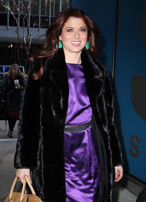 "Debra Messing looks ""smashing"" in a bright purple, satin dress as she leaves ""Live with Kelly"" on February 6, 2012 in New York City, NY. Debra is currently promoting her new show ""Smash."""