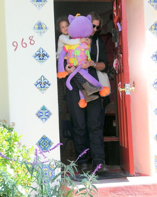 Model Gabriel Aubry picks up his daughter Nahla from school on February 8, 2012 in Los Angeles, CA. Nahla was barely visible behind the giant, purple stuffed animal she was carrying!