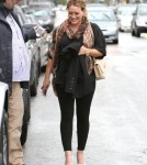 Hilary Duff heads out into the rain after eating lunch at a restaurant on February 15, 2012 in Beverly Hills, CA.