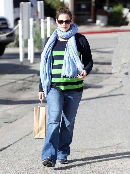 Pregnant actress Jennifer Garner starts her morning off on a healthy foot with some juice from Pressed Juicery on February 21, 2012 in Brentwood, CA.
