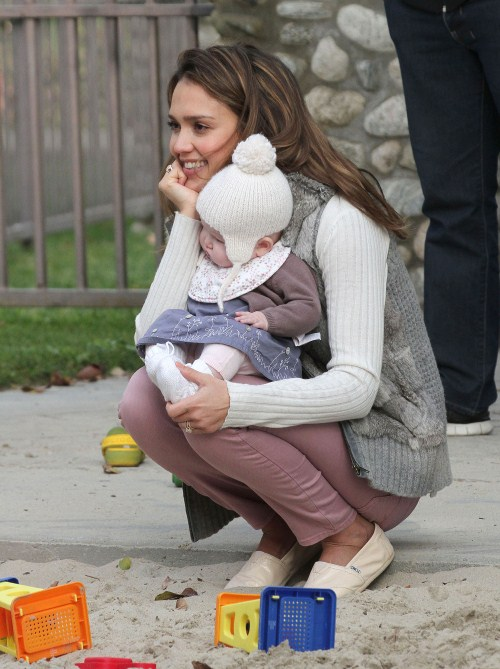 Jessica Alba and her husband Cash Warren play with their kids Honor and Haven at Coldwater Park on February 12, 2012 in Beverly Hills, CA.