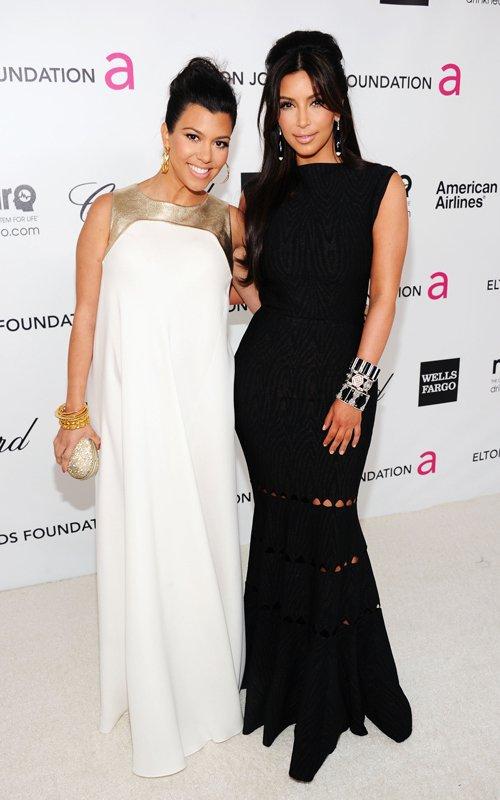 Kim and Kourtney Kardashian at the 20th Annual Elton John AIDS Foundation's Oscar Viewing Party (February 26)