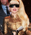 Lady Gaga looks festive as she makes her way out of her hotel in NYC, NY on December 31, 2011.