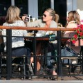 Pregnant actress Molly Sims showing off her sonogram pictures to friends while out for lunch at Cafe Med in West Hollywood, CA on February 19, 2012